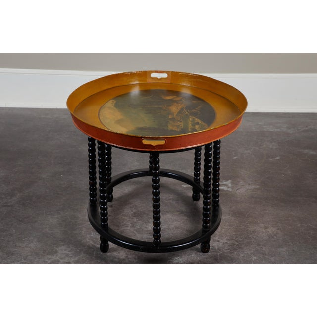 A Danish tole tray table, featuring a West Indies motif and a newer stand, circa 1835. Stand features the ever-popular...