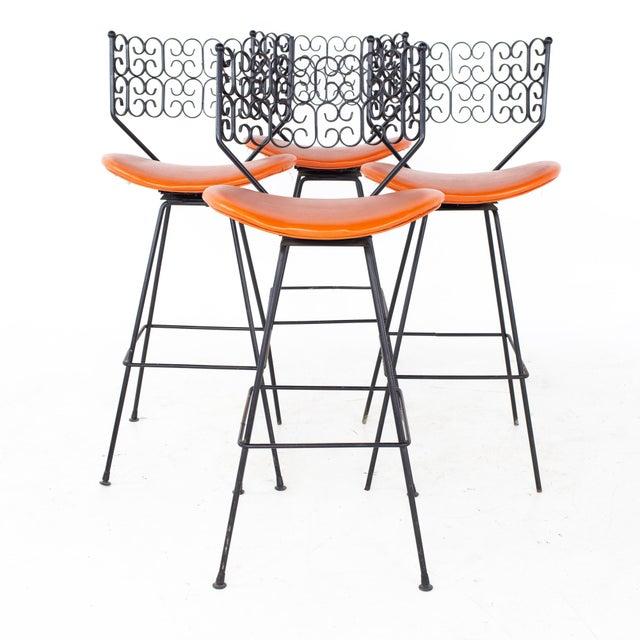 Arthur Umanoff Mid Century Iron Granada Swivel Barstools - Set of 4 Each stool measures: 18.5 wide x 19.5 deep x 41.5...
