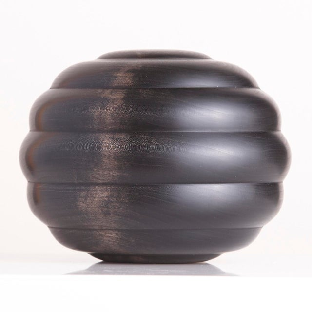 An exclusive series of beautifully turned and ebonized cherry wood bowls from Scott Alexander, of Alexander Designs. The...