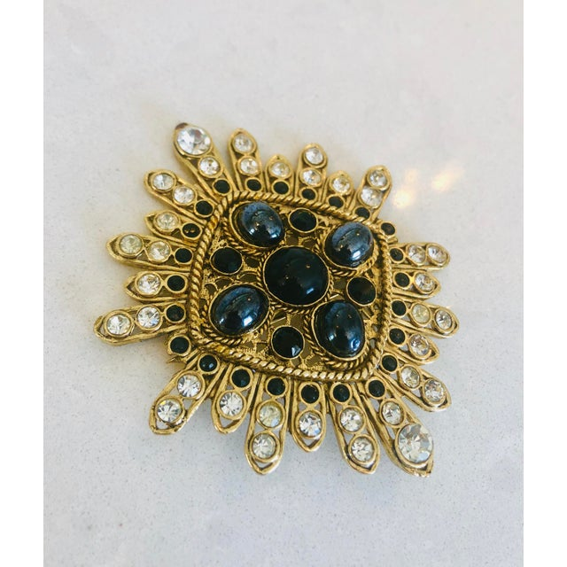 Stunning crystal embellished pin with braided and filigree detail. Quality crystals interspersed with hematite like...