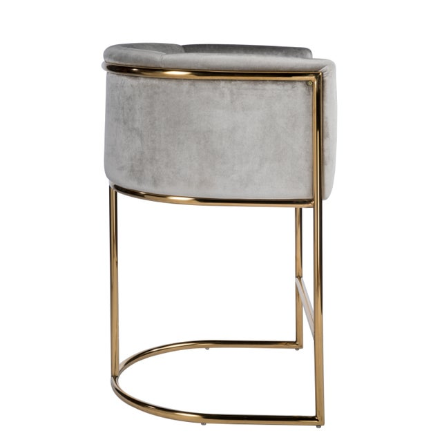 """This is a new Mira Gold counter chair. Multiples available. Materials: Stainless steel, velvet Measurements : 23.5""""w x..."""