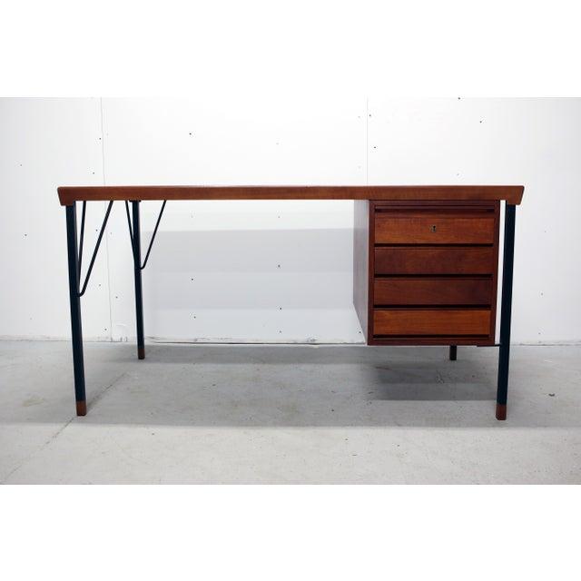 Vintage 1960s teakwood desk manufactured by John Stuart Inc. Has original tag on the inside of the top drawer. This desk...