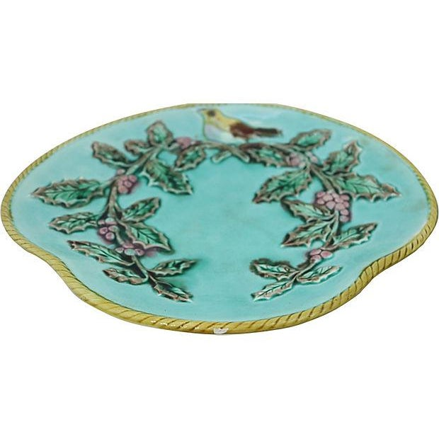 Pair of antique English majolica serving plates with birds. Raised rope edge detailing. No maker's mark. Light wear,...