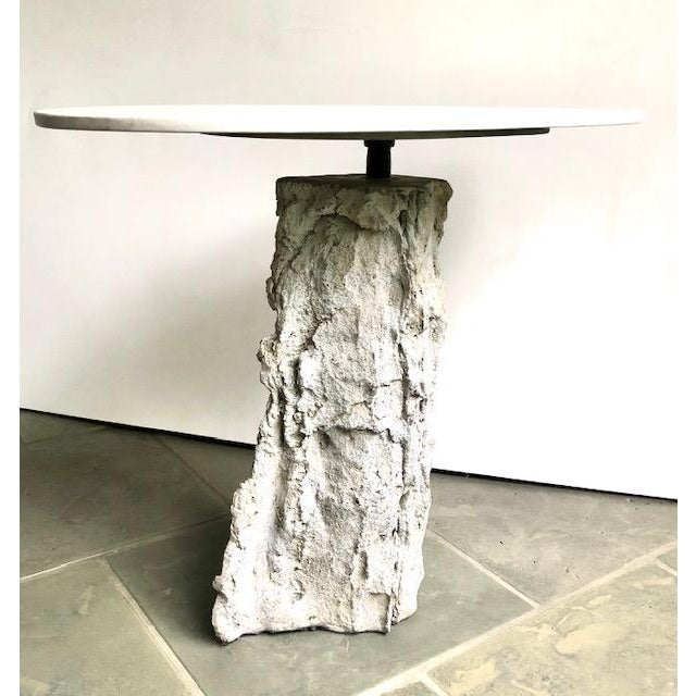 Unique and one of a kind accent table constructed of cast stone and terrazzo. The oval terrazzo top is cast with marble...