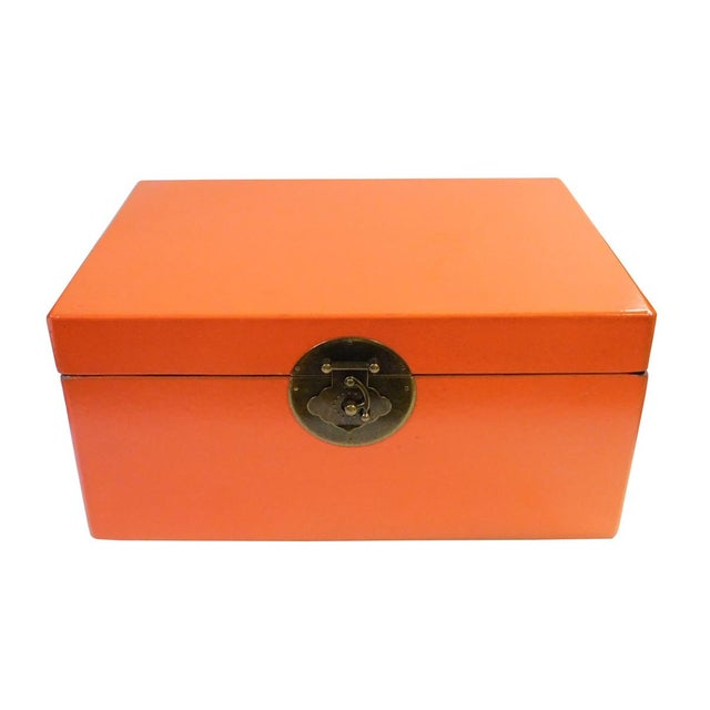 This is a Chinese decorative box in rectangular shape and round hardware accent. The surface is a layer of vinyl cover in...
