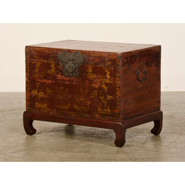 A red lacquer antique Chinese trunk having gold painted decoration Kuang Hsu period circa 1875 with the original metal...