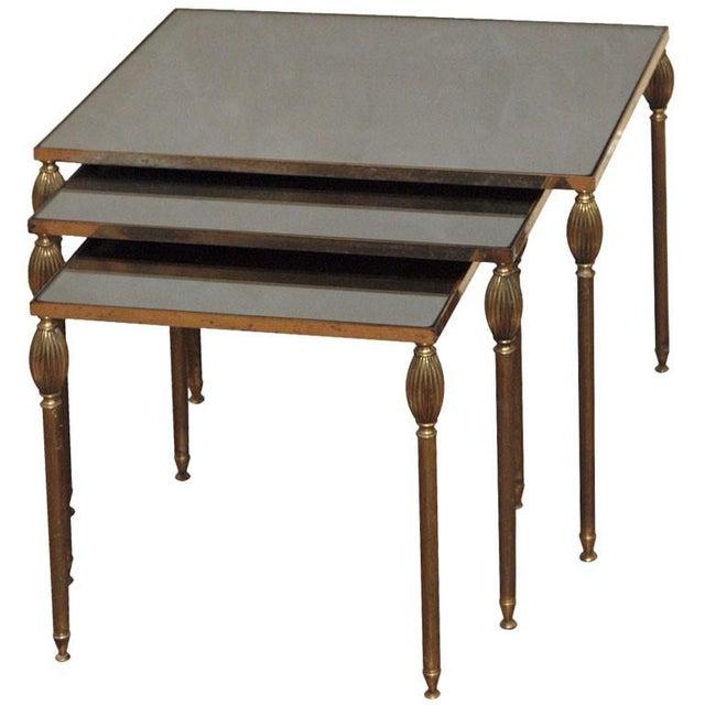 Mid-Century Set of 3 Nesting Tables With Smoked Glass La 21 Wa 16 Ha 17. Lb 17.75 Wb 14 Hb 15.5. Lc 14 Wc 13.5 Hc 14.5.