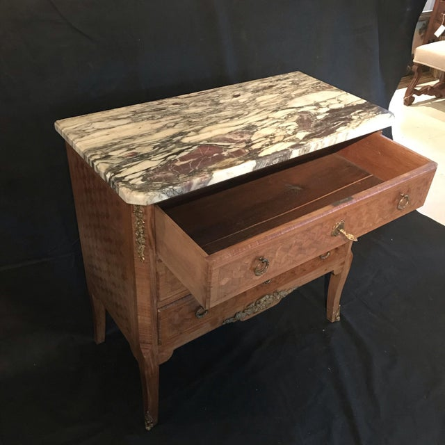 Late 19th century transitional style walnut and fruitwood marquetry commode with three drawers, topped with a gorgeous...