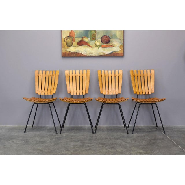A lovely set of four of Arthur Umanoff's iconic 1950s wood and iron chairs made by Shaver Howard for Raymor. These chairs...