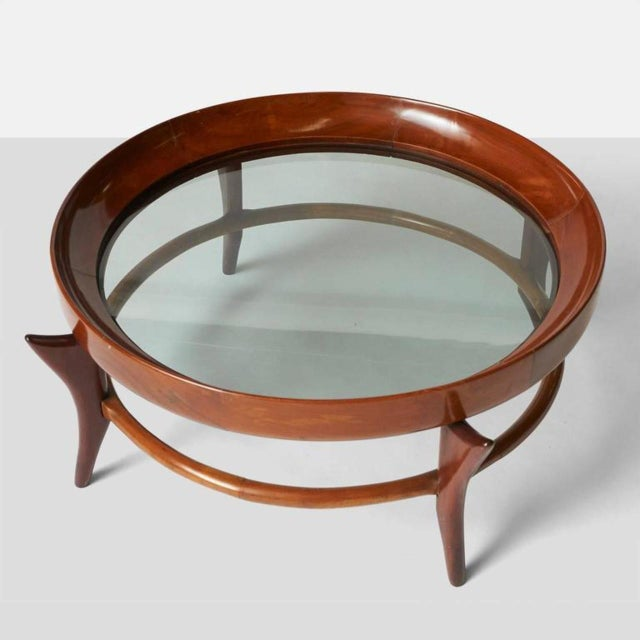 "A circular ""maracana"" coffee table by Giuseppe Scapinelli in Brazilian jacaranda wood with an inset glass top."