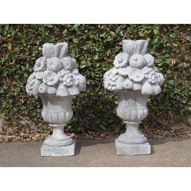 This Italian vase has a fruit and floral bouquet cascading from a fluted neck. The body of the vase is a series of...