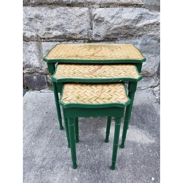 Very pretty vintage painted cane wicker top nest of 3 side tables with a palm tree motif,the wood frame and legs are...