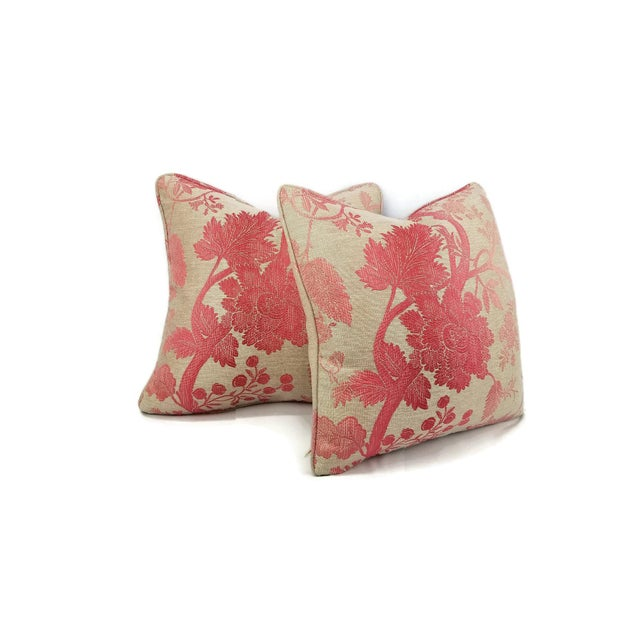 From Nina Campbell is Amazonas in pink. This a lovely bright pink floral pillow with an ombre-like effect on a light tan...