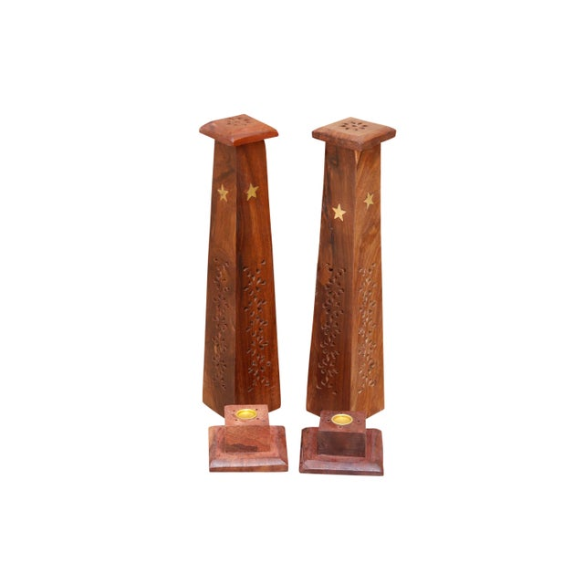 A pair of wooden tower shaped incense burners with brass star inlay. Each tower can hold up to four incense sticks...