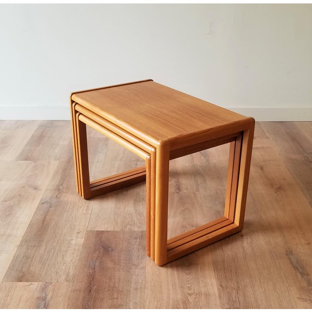 Fully restored set of Danish teak nesting side tables. A very functional design to have three side tables collapse into...