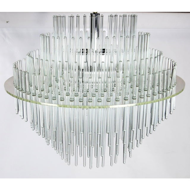 Lucite, chrome, and glass rod Chandelier by Lightolier lit by four candle-base uplights and four downlights....eight...