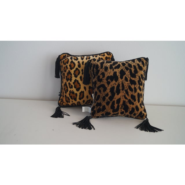 Mini Throw Pillows 2 with black tassles. Cheetah and Leopard prints. Size 8x8 Uniquely beautiful. Sold as a pair.