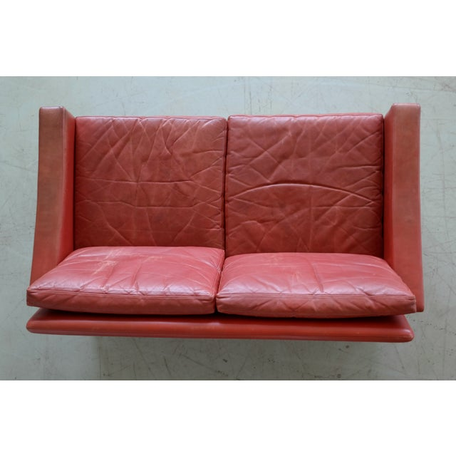 Classic Danish Mid-Century Modern Sofa in Red Leather and Rosewood Base For Sale - Image 9 of 11
