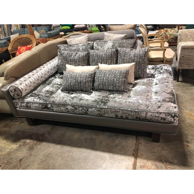 Soft and luxurious silver crushed velvet covers the cushions, the frame is upholstered in a metallic faux leather. This...