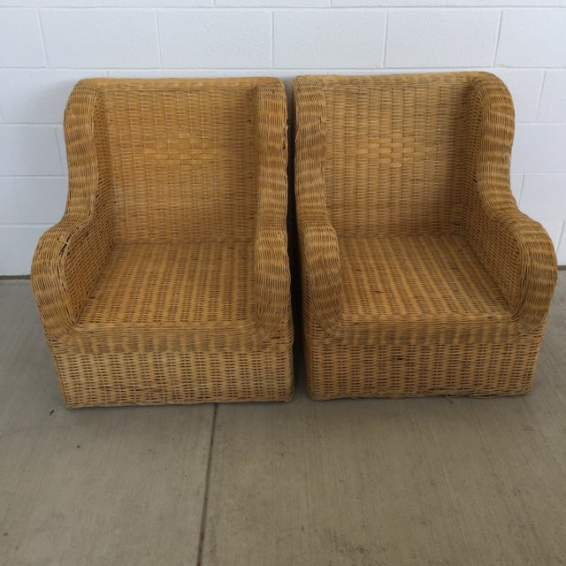 Great vintage rattan club chairs in need of some fabulous cushions. Made in the 1970s
