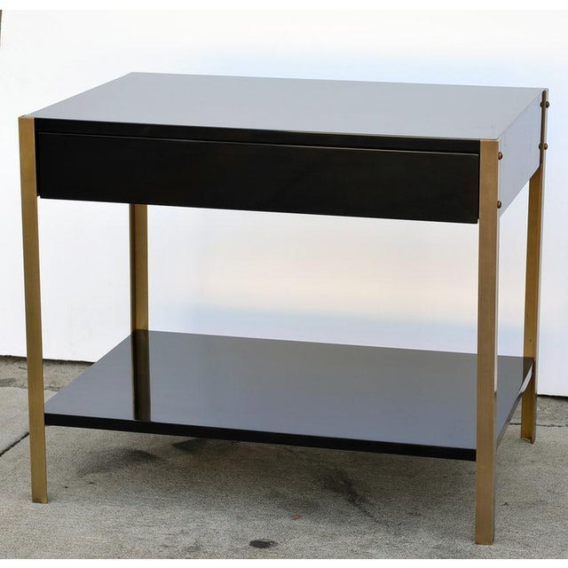Chic high gloss black lacquer and brushed (not polished) brass night stand. Soft close drawer slides. Bottom shelf height:...