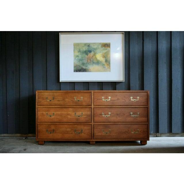 Iconic Henredon Artefacts 6-Drawer dresser with brass pulls. This wonderful piece has ample storage and is useful as...