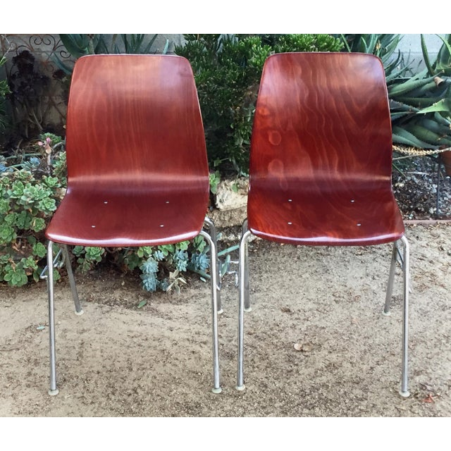 Vintage Royal Pagholz bent plywood stacking chairs. Stack neatly and can lock together. They have a few minor nicks and...