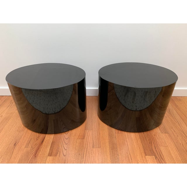 A set of matching 1980s contemporary oval tables that would work well as end tables, night stands or arranged together as...