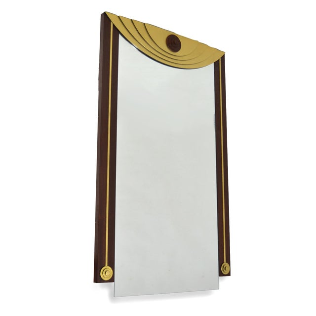 This large wall mirror has a strong post-modern aesthetic and interesting details such as the bottom edge of the mirror...