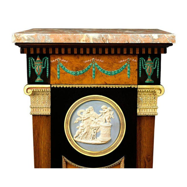 A glorious specimen of Sheraton Revival furniture, this exquisite display pedestal features the stylistic elements...