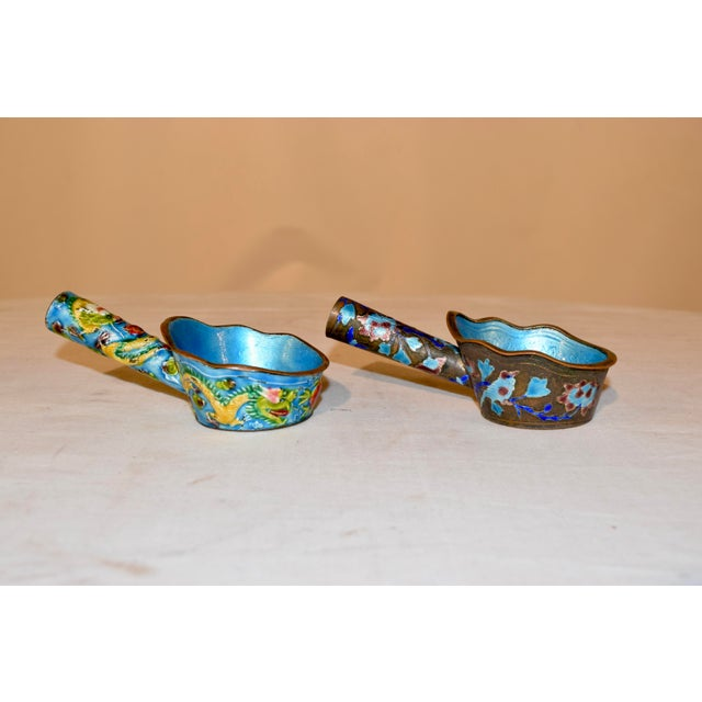 Pair of late 19th century antique copper water dipping or sauce ladles which are very ornate. they are hand enameled with...
