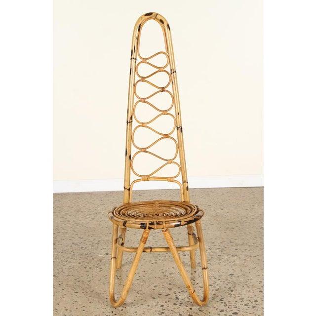 An Italian rattan chair having circular seat and s-form back.