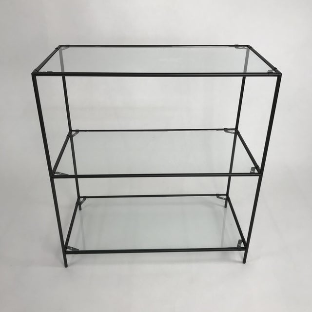 Black powder coated metal with glass shelf bookshelf designed by Poul forCadovius Abstracta. The glass is custom cut with...