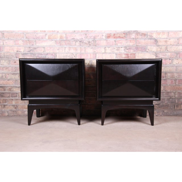 A stunning pair of mid-century modern diamond front nightstands In the manner of Vladimir Kagan By United Furniture Co....