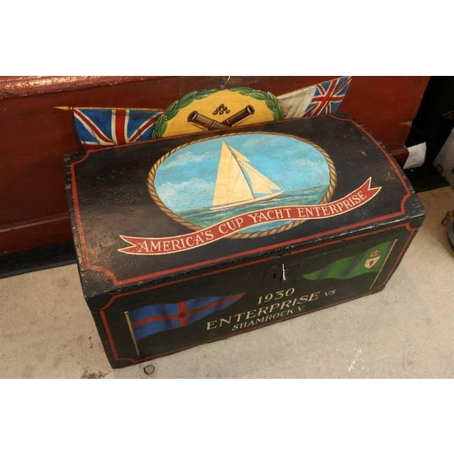 """Showing the America's cup yacht enterprise. Chest is old, paint is new. Old paper interior. Dimensions: 28"""" L x 12"""" W x..."""