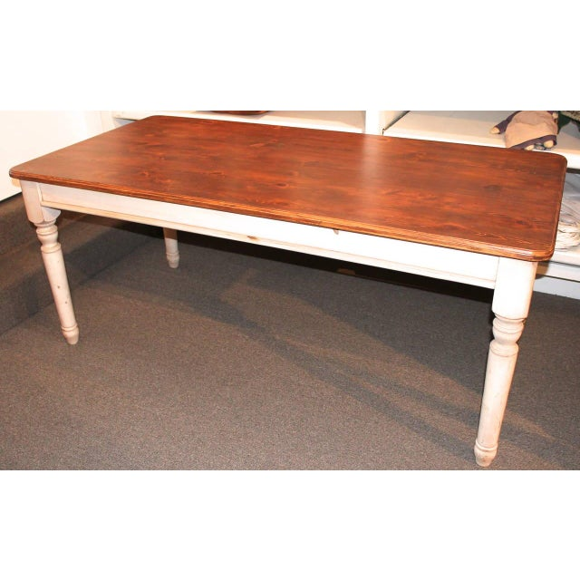 This large late 20th century harvest table is a newer version of the 19th century large farm or harvest tables that are so...