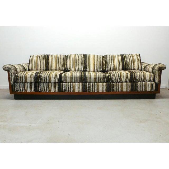Stunning long low 70's mid century BOHO modern walnut Milo Baughman style box side case sofa with Alexander Girard...
