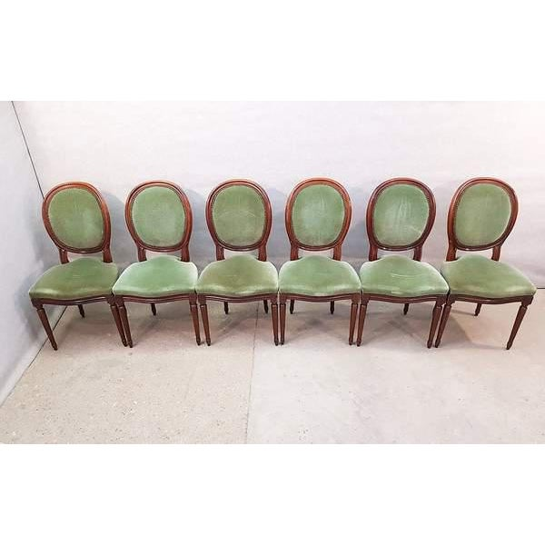 Very elegant set of 6 Louis XVI style dining room chairs. The chairs have classical oval backrests on tapered fluted legs...