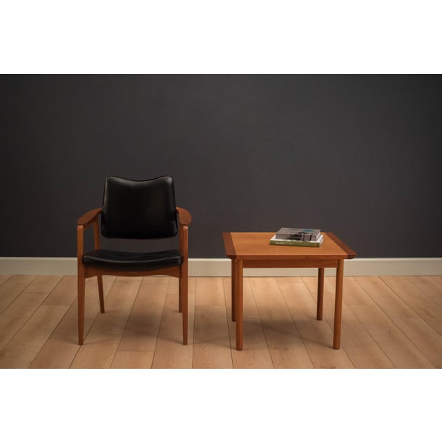 Mid-century modern square end table by Westnofa of Norway in teak. Features solid teak curved edges and linear dowel legs....