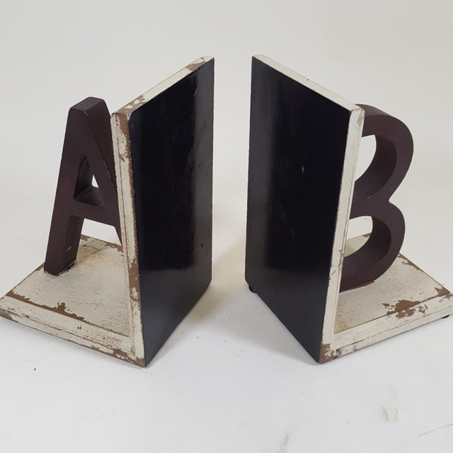 This set of bookends are new but made to look old. One has the letter A and the other the letter B. Great for a children's...
