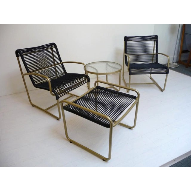 This set of Brown Jordan patio furniture is so glamorous! We've had them professionally restored in black yacht cording...