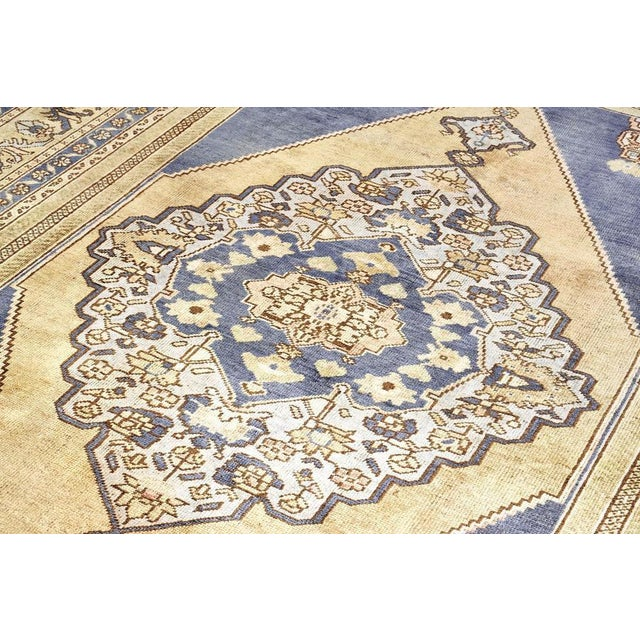 This beautiful Turkish rug is a great way to dress up, and protect, any floor in your home. This blue rug is light and...