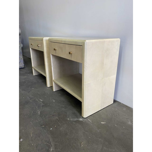 A pair of single drawer nightstands in ivory gloss faux vellum finish. Incomparable quality and classic lines, practical,...