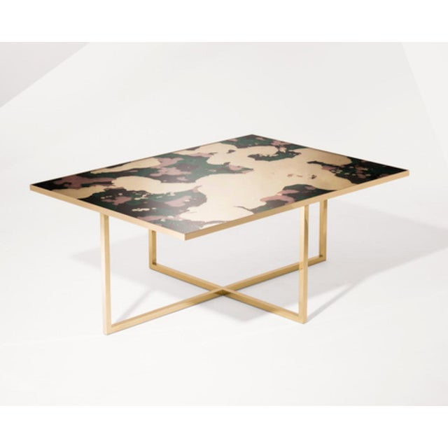 The Steppe Cocktail Table by Emma Peascod is available in a variety of metals with a top available in four handmade verre...