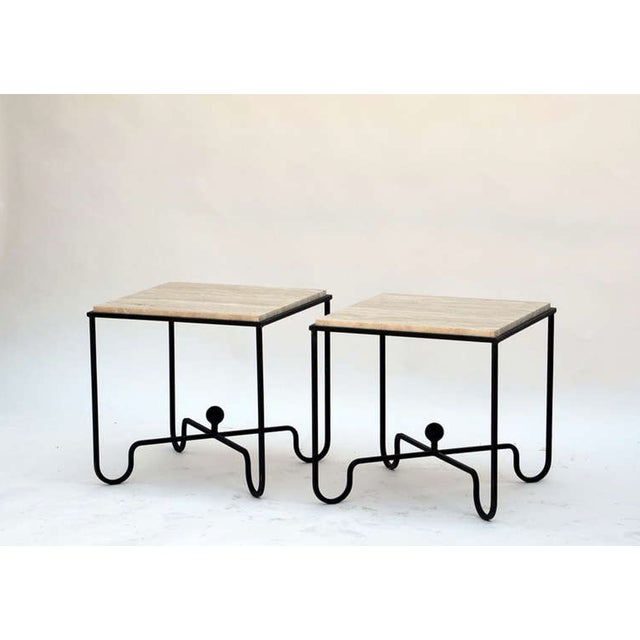 "The ""Entretoise"" wrought iron and travertine table."