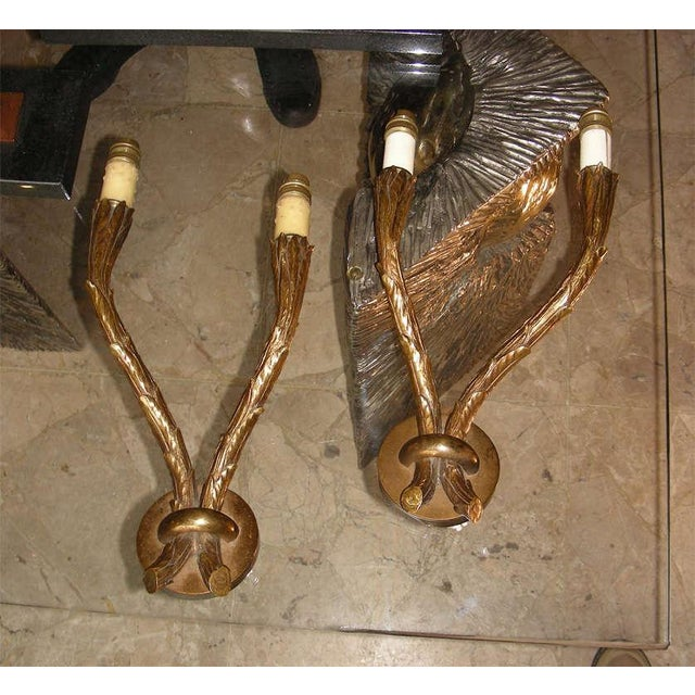 Two 1950-1960 bronze sconces by Maison Baguès, with a leaf decoration. Solid bronze High quality