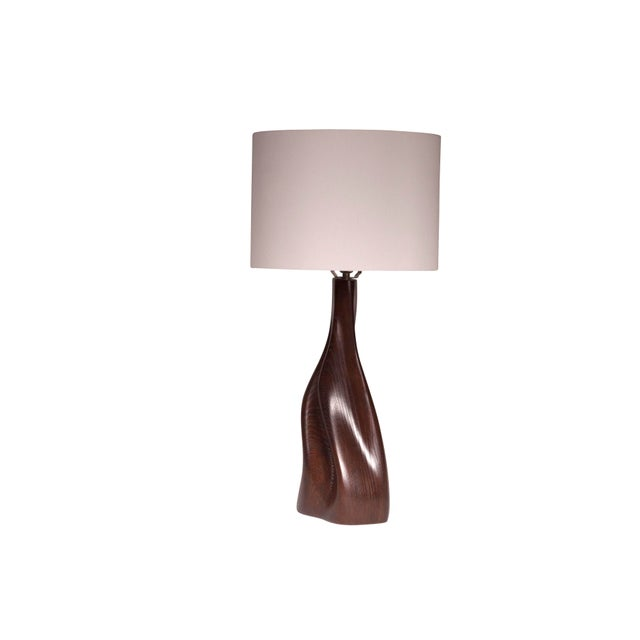 """Nectar table lamp is a dynamic shape table lamp with gold finish. Dimension of the table lamp is 9.5"""" L x 6"""" W x 19"""" H...."""