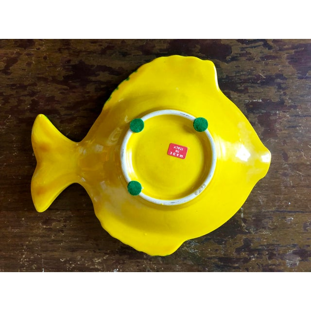 Vintage yellow and green pottery fish dish. 'Made in Italy' sticker on bottom.