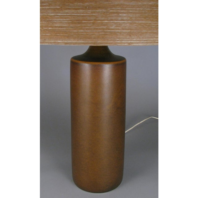 A very handsome 1960s Danish ceramic lamp by Lotte & Gunnar Bostlund, with a cylinder shape, in a medium brown color with...