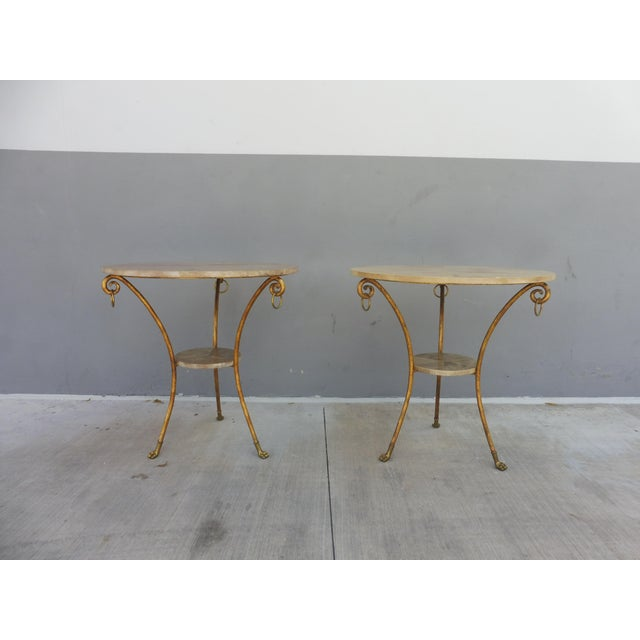 Wonderful pair of parcel gilt wrought iron and goat skin tables sold as found previously owned showing normal signs of...